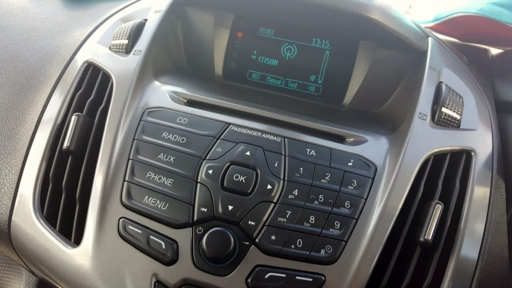 A close up shot of the dashboard of the Ford Tourneo Connect. The radio is tuned into 'itison'