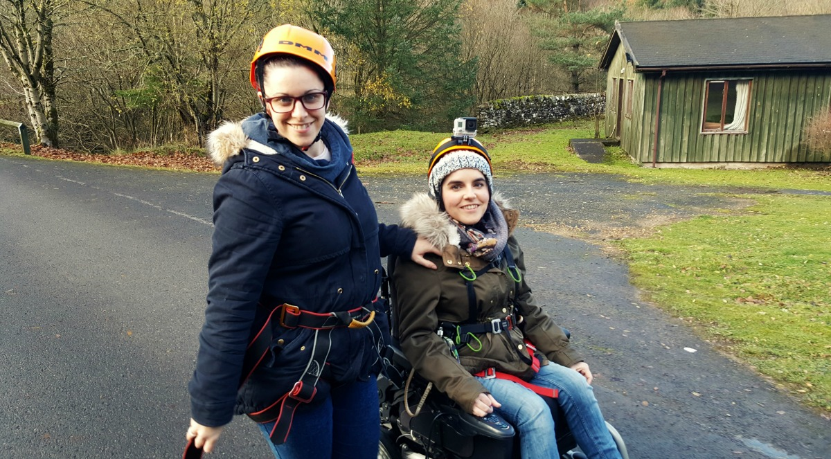 Emma and her sister wearing safety helmets and harnesses.