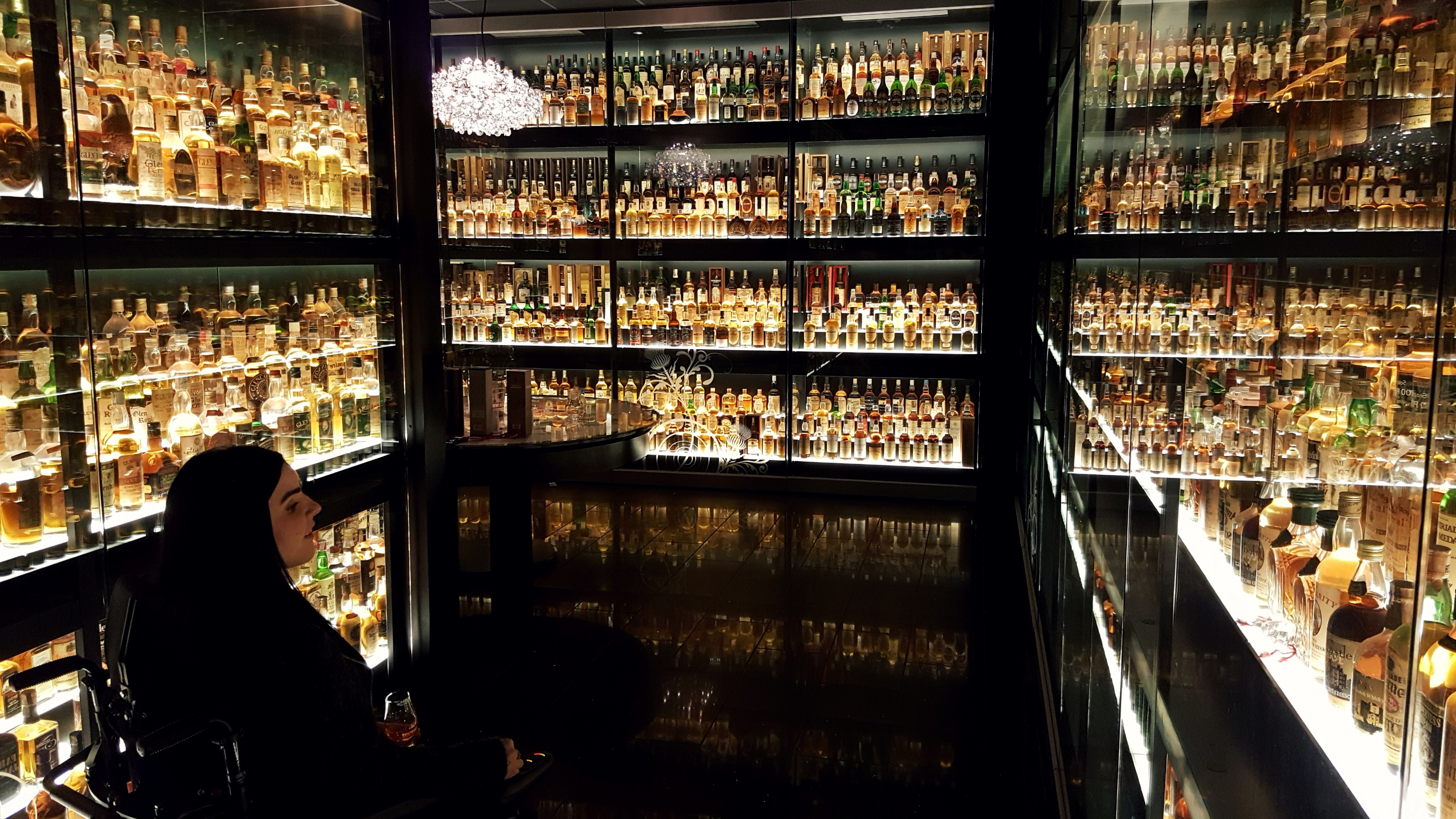 Emma inside The Diageo Claive Vidiz Scotch whisky collection at The Scotch Whisky Experience Edinburgh