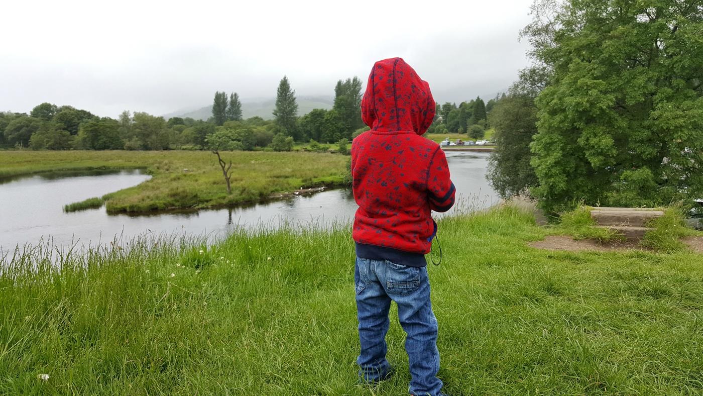 little boy overlooking river in callander