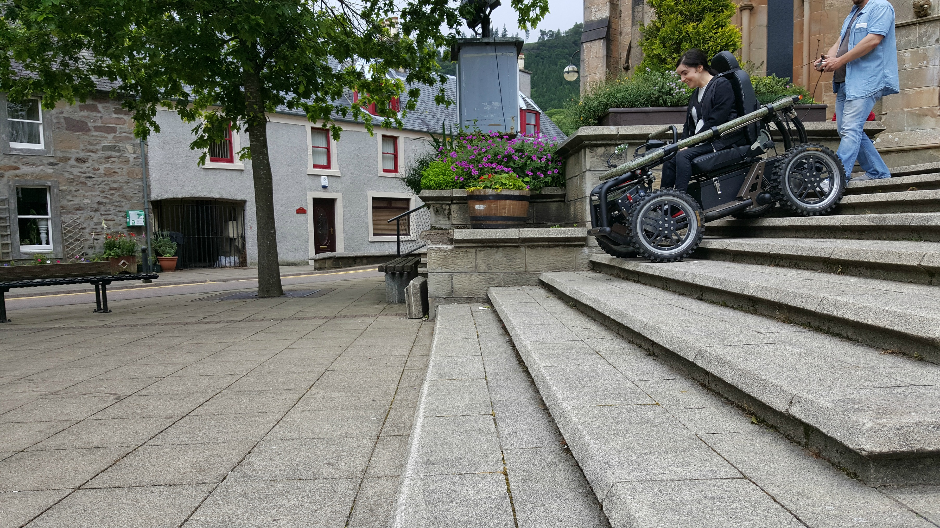 simply emma driving all-terrain-wheelchair down steps callander