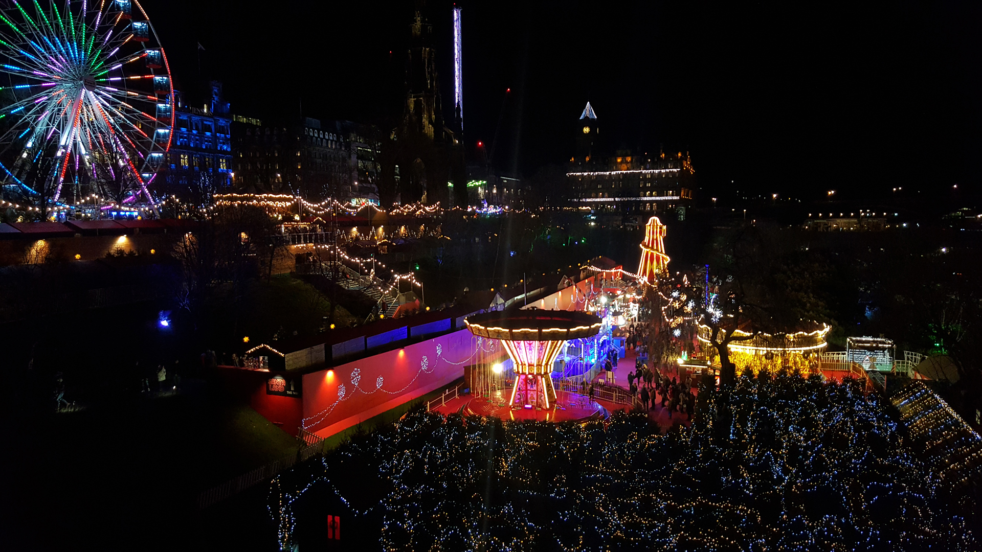 A shot overlooking Edinburgh's Christmas market at night time.