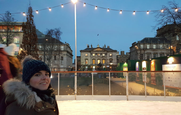 Wheelchair user ice skating at Edinburgh's Christmas