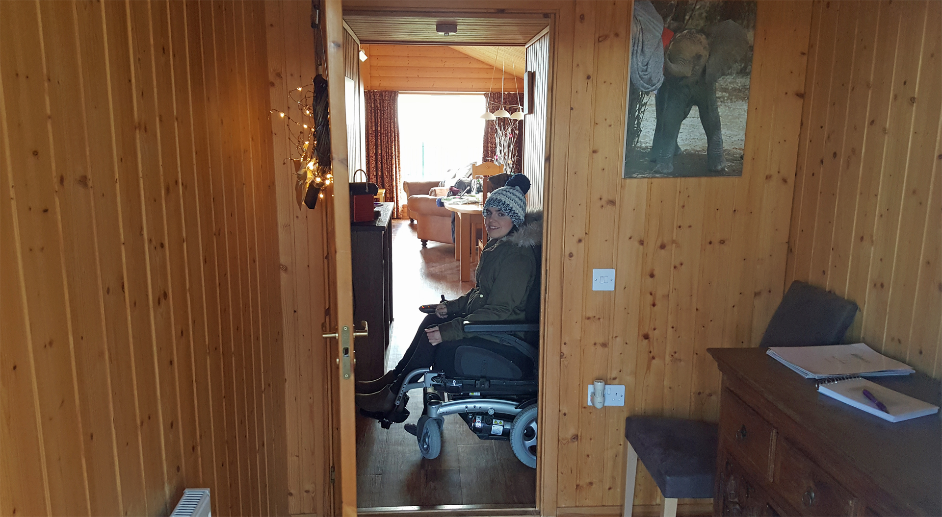 Wheelchair user in the hallway of The Ramsay lodge at Airhouses Luxury Self Catering Lodges in Scottish Borders