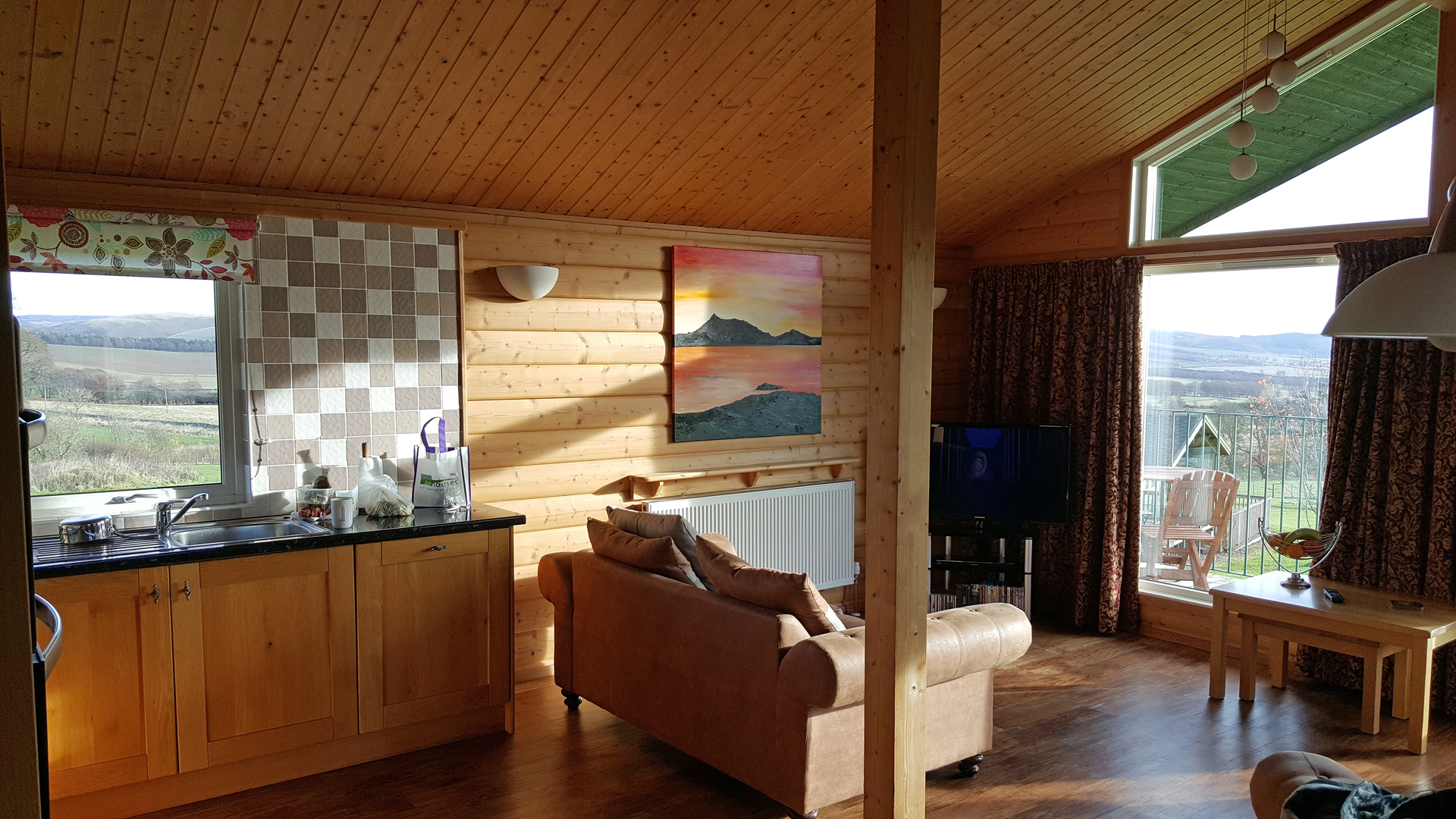 Open plan kitchen and living area in The Ramsay at Airhouses Luxury Self Catering Lodges in Scottish Borders