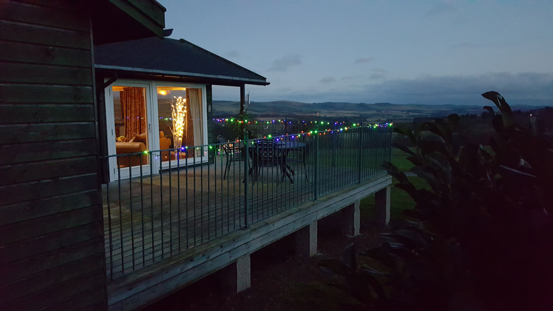 Christmas lights decorating the patio decking area at Airhouses luxury lodges.