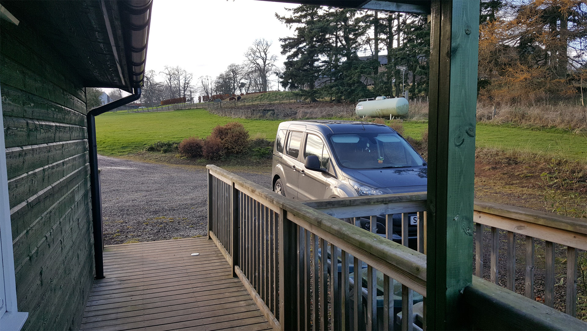 Parking bay outside The Ramsay accessible lodge with level decking.