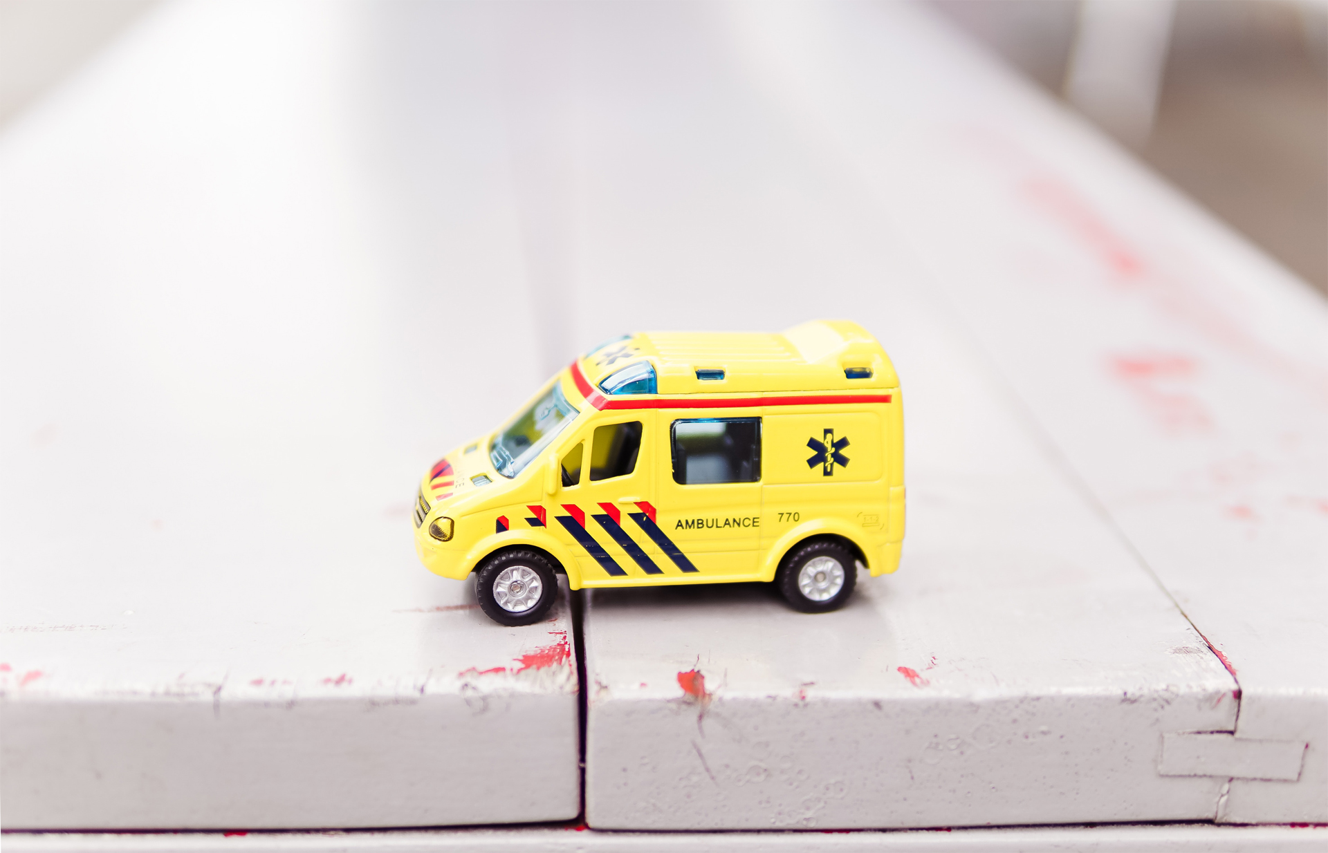 Picture of a yellow toy ambulance,
