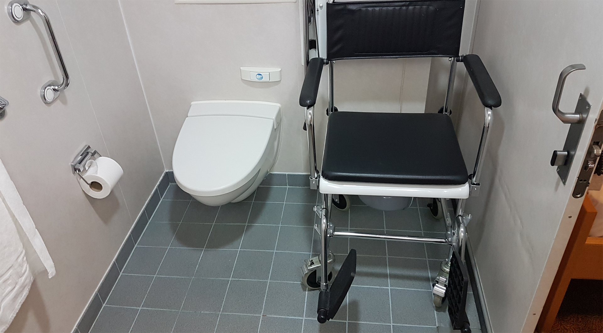 NorthLink Ferries wheelchair accessible cabin bathroom with shower commode chair.
