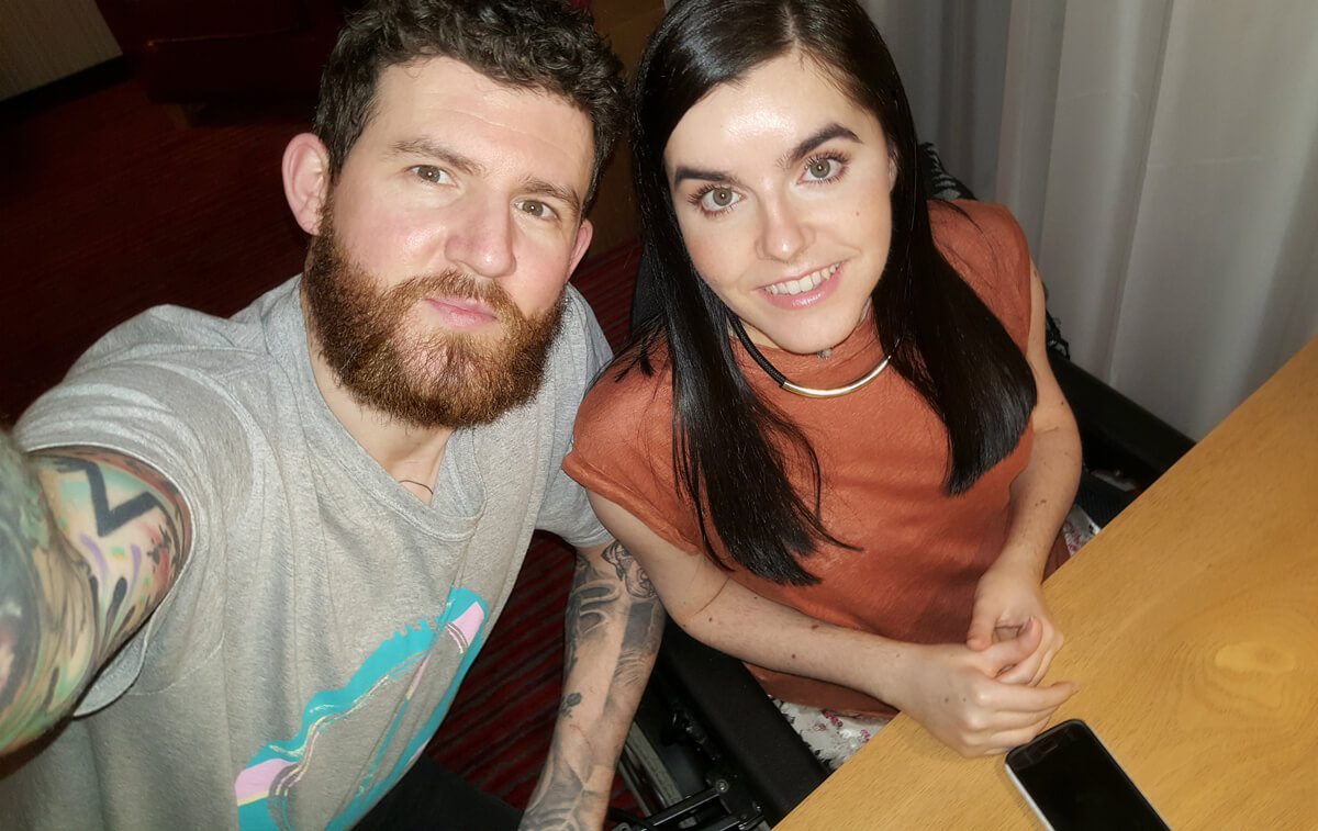 Emma and Allan take a selfie in their Park Inn by Radisson Aberdeen hotel accessible room