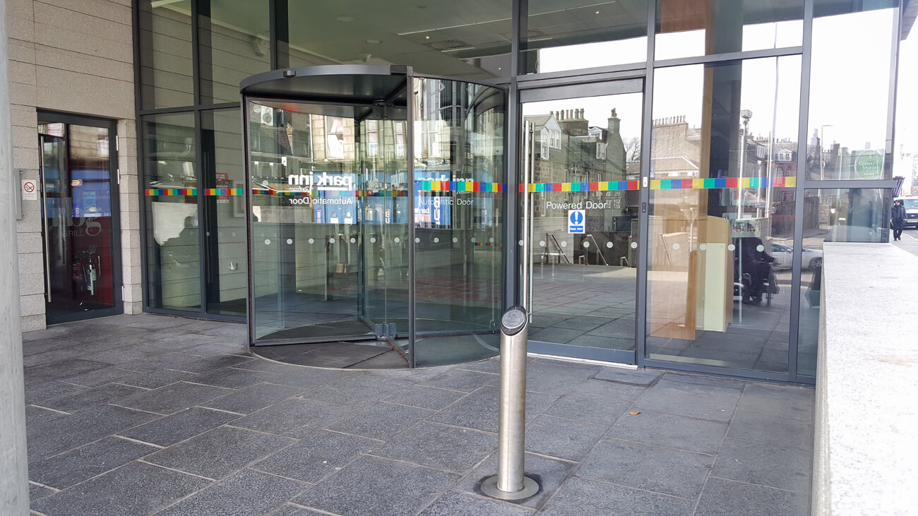 Revolving door and wheelchair accessible automatic door at the hotel entrance of Park Inn by Radisson Aberdeen