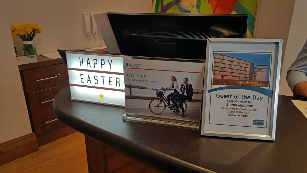 Staybridge Suites Newcastle Wheelchair access review - Reception desk with Quest of the Day sign
