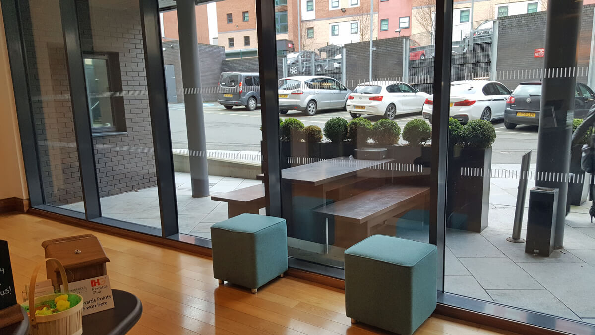 Staybridge Suites Newcastle Wheelchair access review - reception area with a view of the hotel carpark