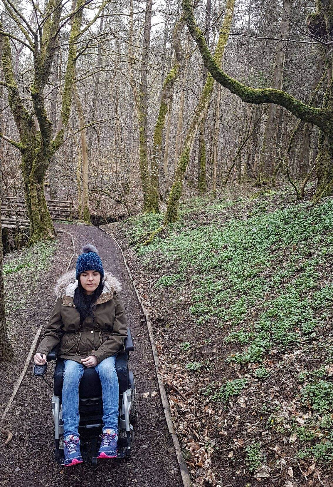 Emma in her powered wheelchair strolling through Calderglen Country Park.