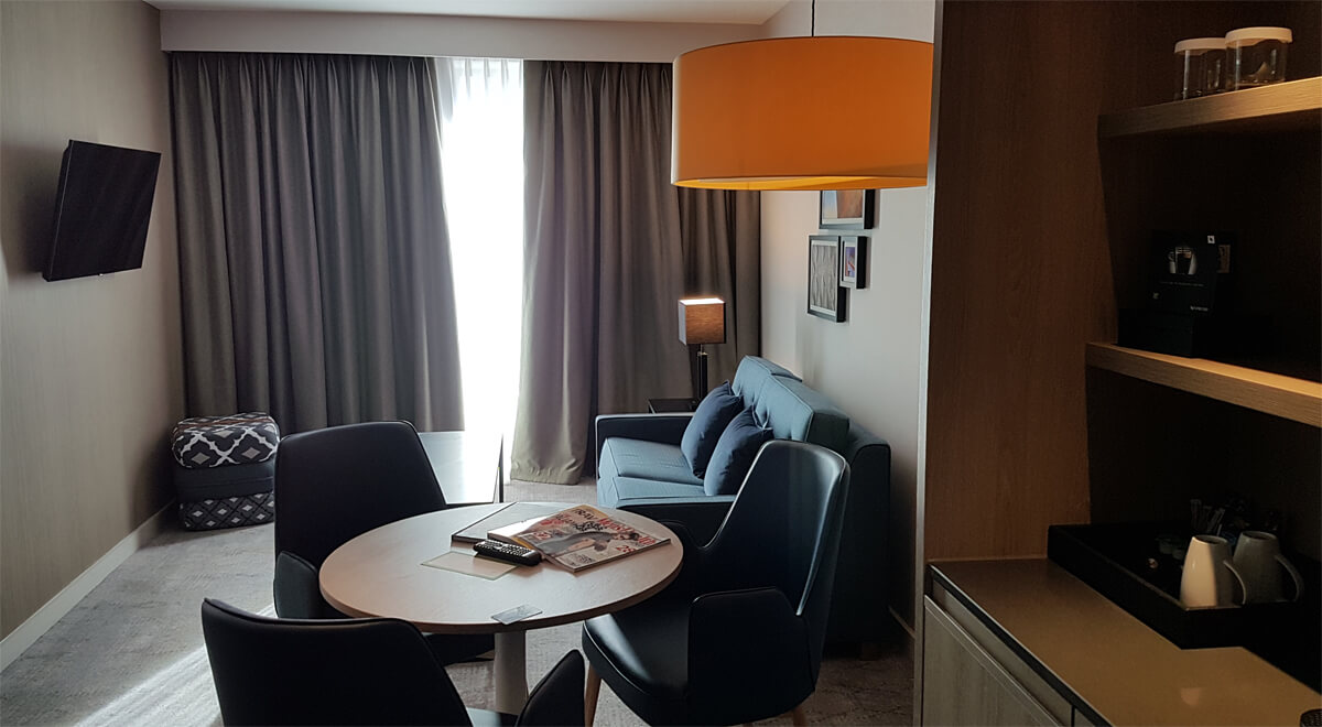 Holiday Inn Manchester City Centre Wheelchair Access Review - living area lounge in wheelchair accessible suite