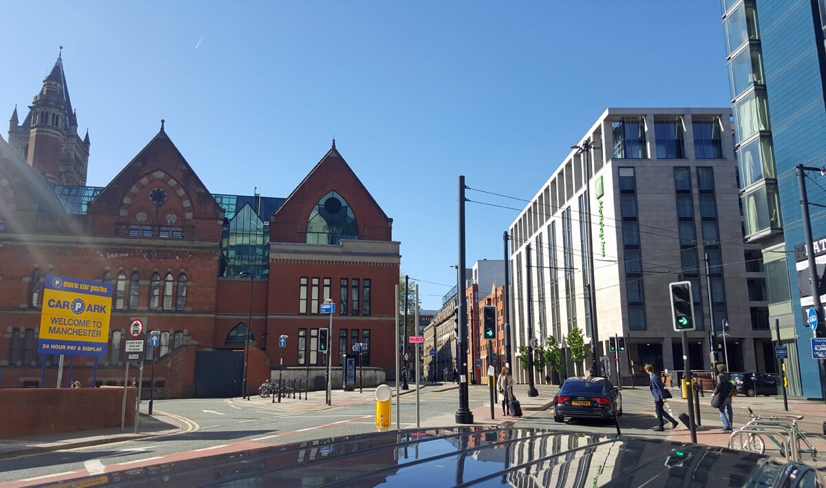 Image of the Holiday Inn Manchester on the right and the NCP on the left which is just across the street from the hotel. It was also a beautiful sunny day