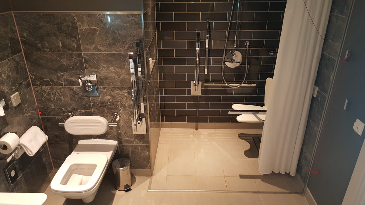 Holiday Inn Manchester City Centre Wheelchair Access Review - wheelchair accessible hotel room suite bathroom roll in shower and toilet