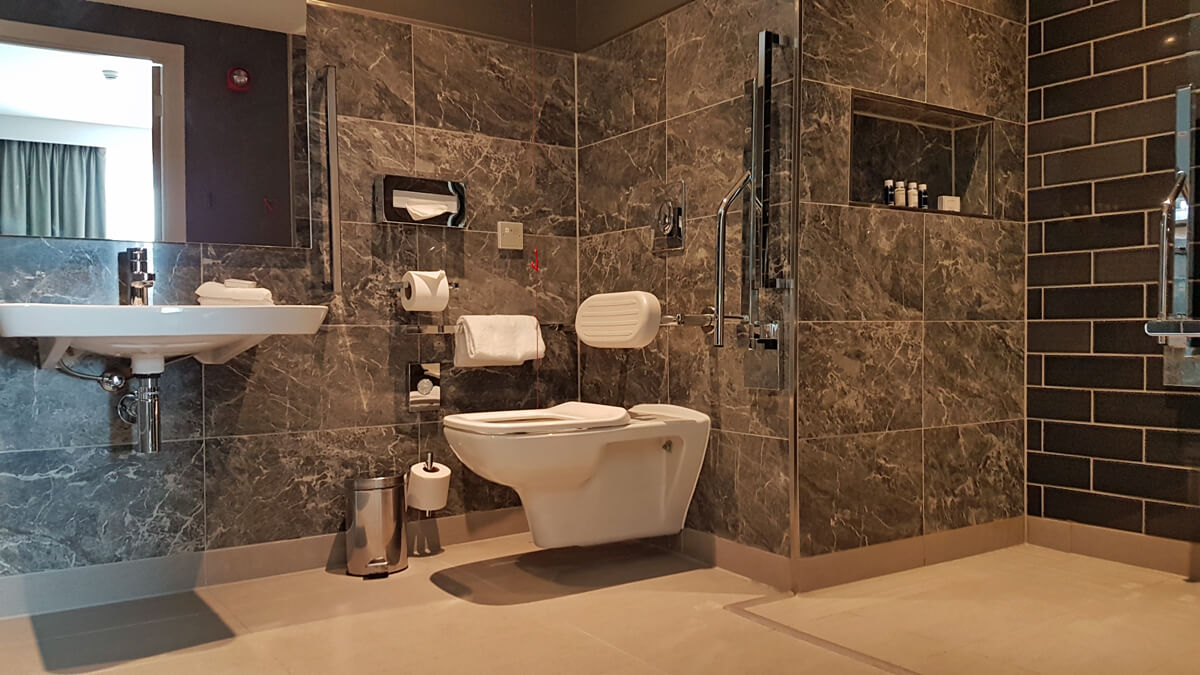 Holiday Inn Manchester City Centre Wheelchair Access Review - wheelchair accessible hotel room suite bathroom toilet and sink