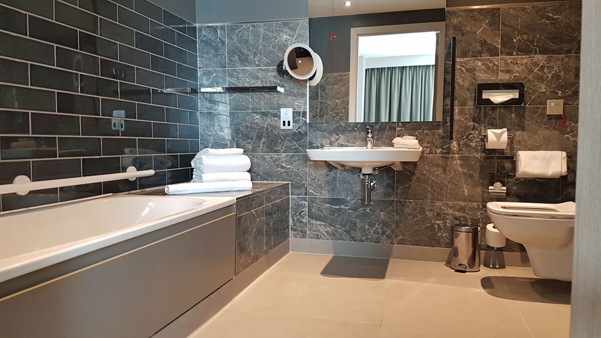 Holiday Inn Manchester City Centre Wheelchair Access Review - wheelchair accessible hotel room suite bathroom toilet, sink and bath