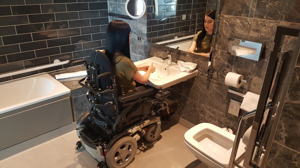 Holiday Inn Manchester City Centre Wheelchair Access Review - wheelchair accessible hotel room suite bathroom with roll under sink