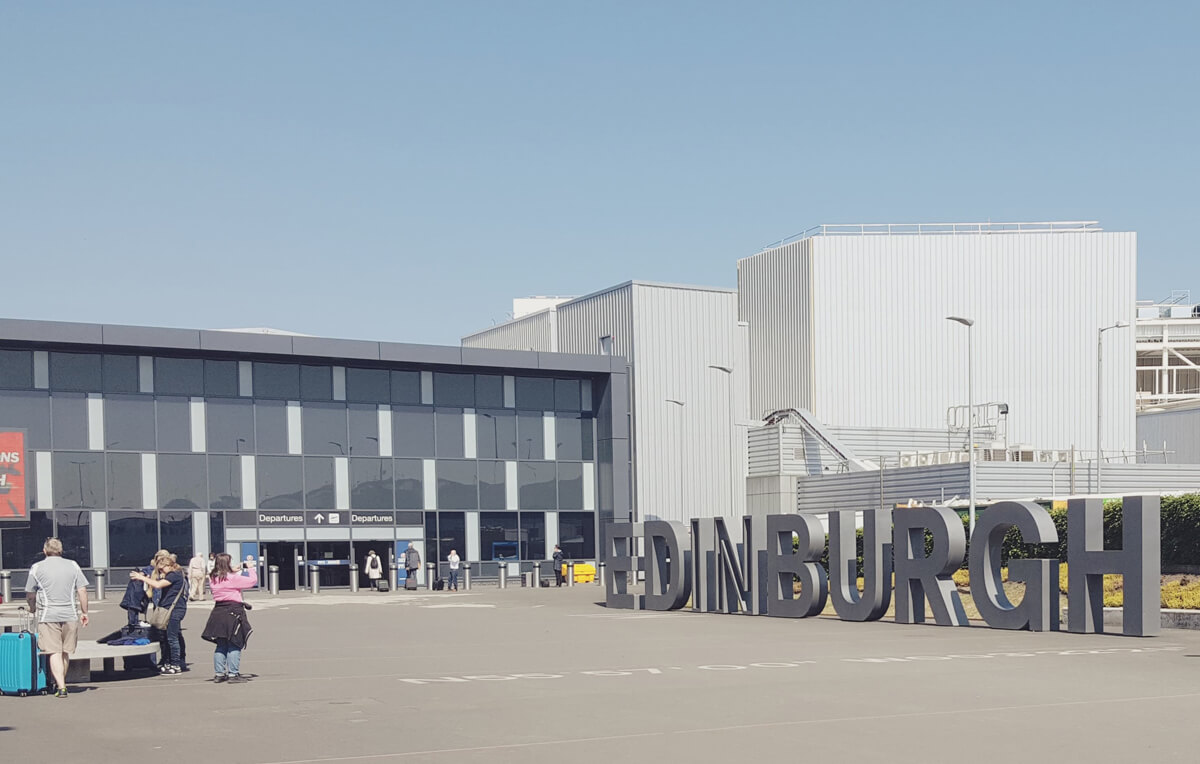 Things-I've-loved-in-May: Edinburgh Airport departures from outside and the large Edinburgh letters.