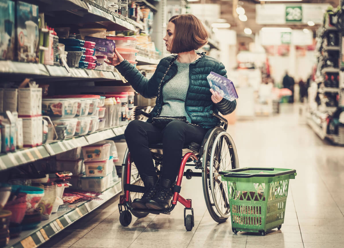 Wheelchair Access and Disability Mediation: A female wheelchair user shopping.