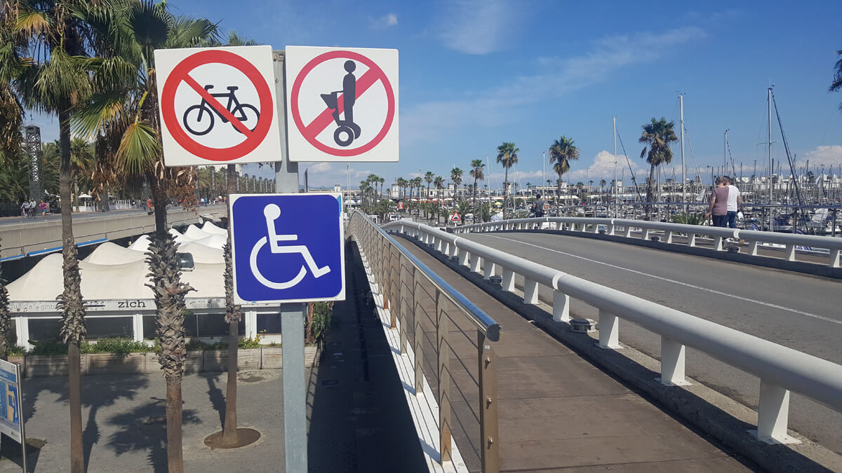 Wheelchair accessible ramp and paths on the promenade on Nova Icaria beach in Barcelona.