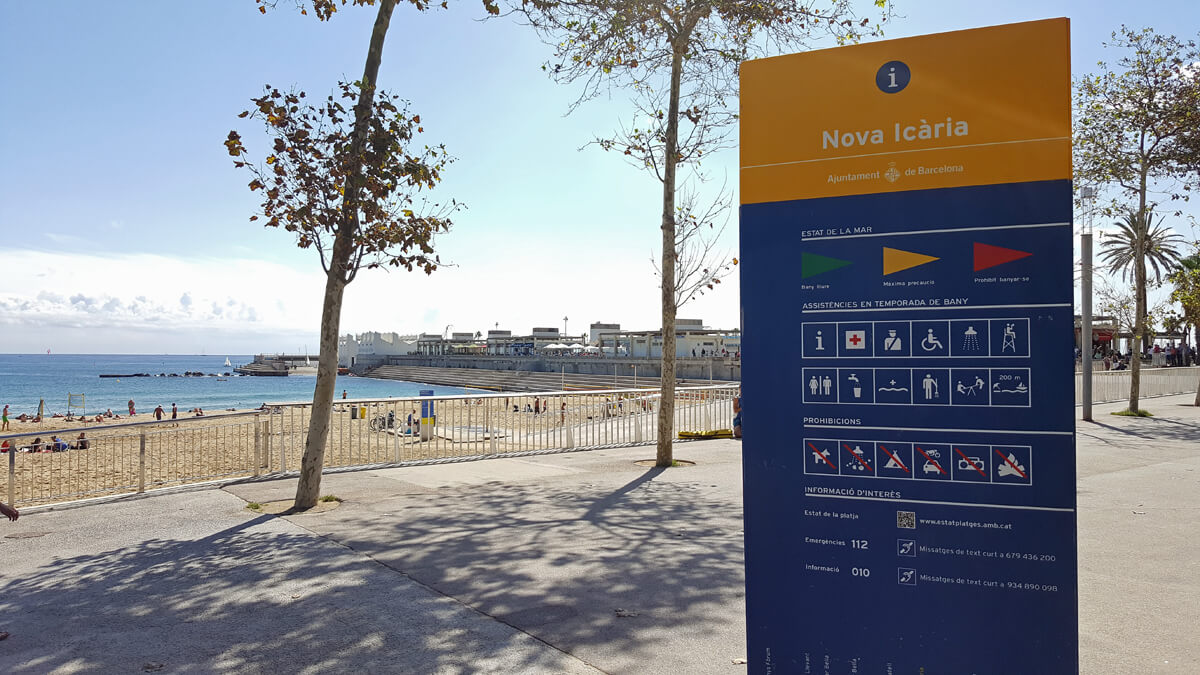 Sign on Nova Icaria Beach in Barcelona showing what accessible and medical services are available to wheelchair users and disabled people visiting the beach.