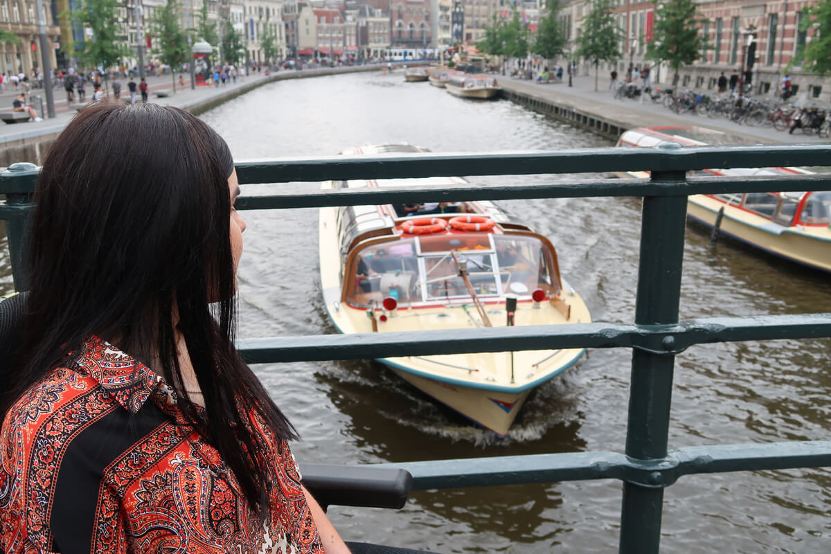 Emma admiring the view overlooking the canal and watching the canal boats sail past.