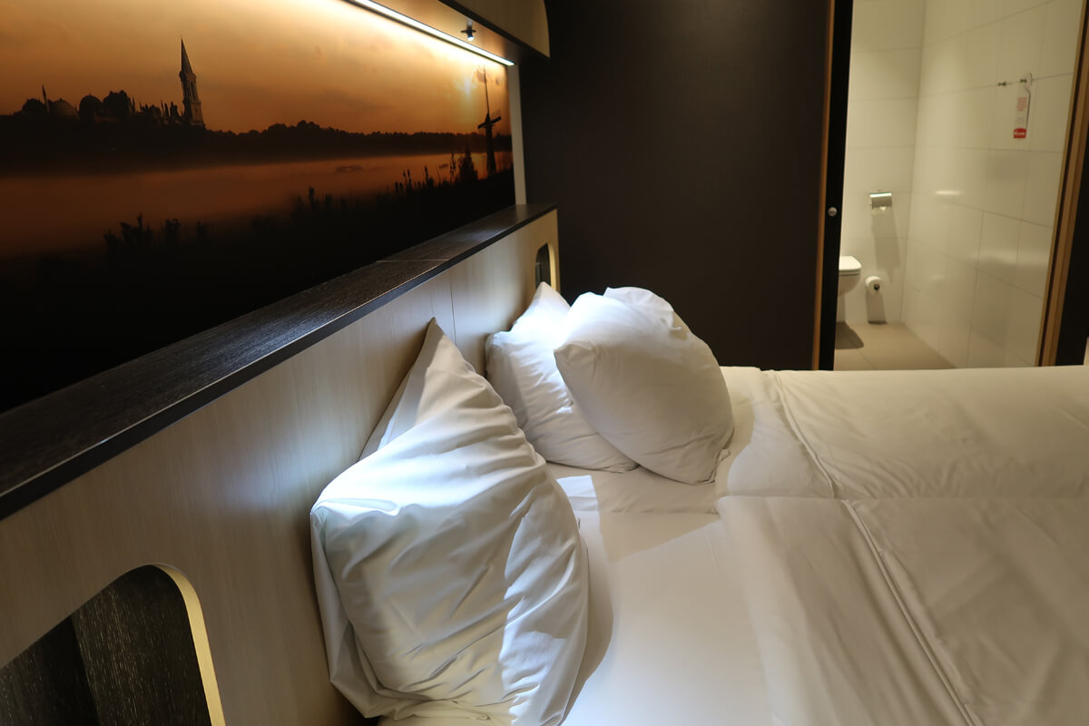 Corendon Vitality Hotel Amsterdam Wheelchair Accessible Hotel In Amsterdam: Bed in the accessible room positoned close to the accessible bathroom.