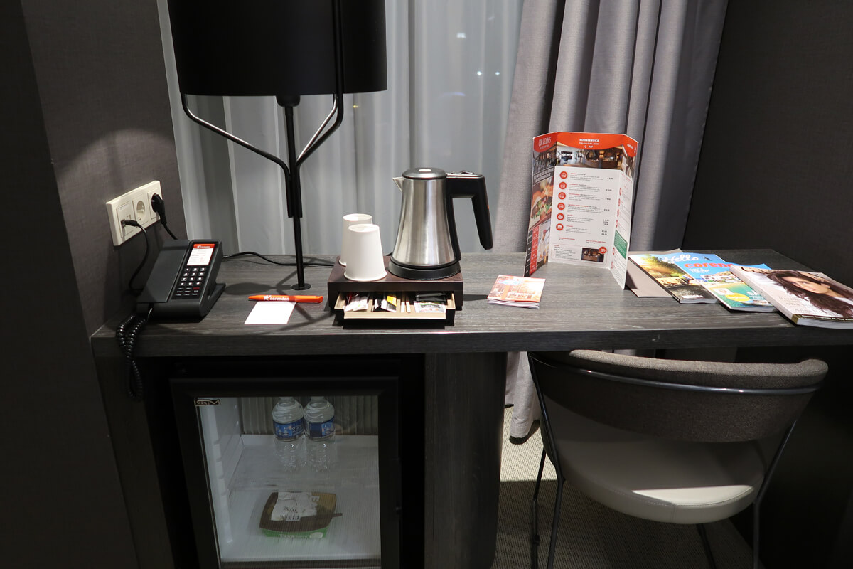 Corendon Vitality Hotel Amsterdam Wheelchair Accessible Hotel In Amsterdam: Work desk positioned close to the window with a minibar and tea/coffee making facilities.
