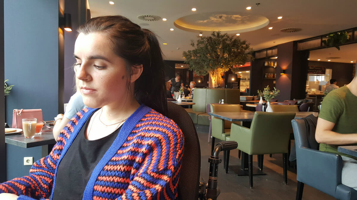 Corendon Vitality Hotel Amsterdam Wheelchair Accessible Hotel In Amsterdam: Emma sitting in the Cor & Don's restaurant at Corendon Vitality hotel in Amsterdam.