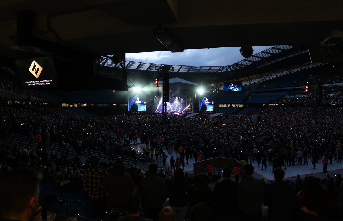 A night shot of Dave Grohl on stage at Etihad Stage