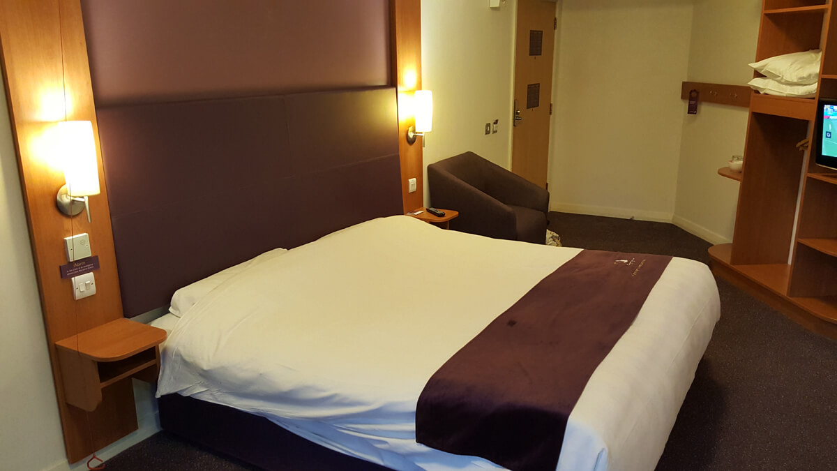 Large comfortable bed in our accessible room.