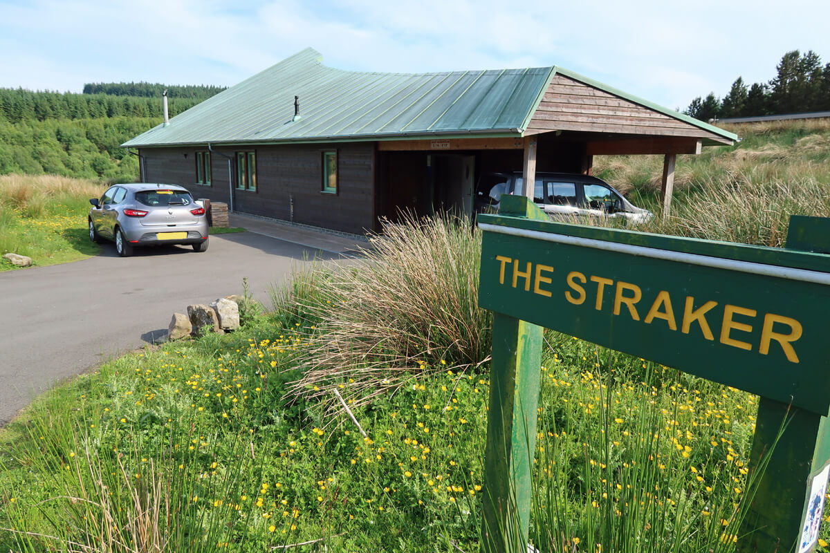 An exterior shot of The Straker chalet and private carpark