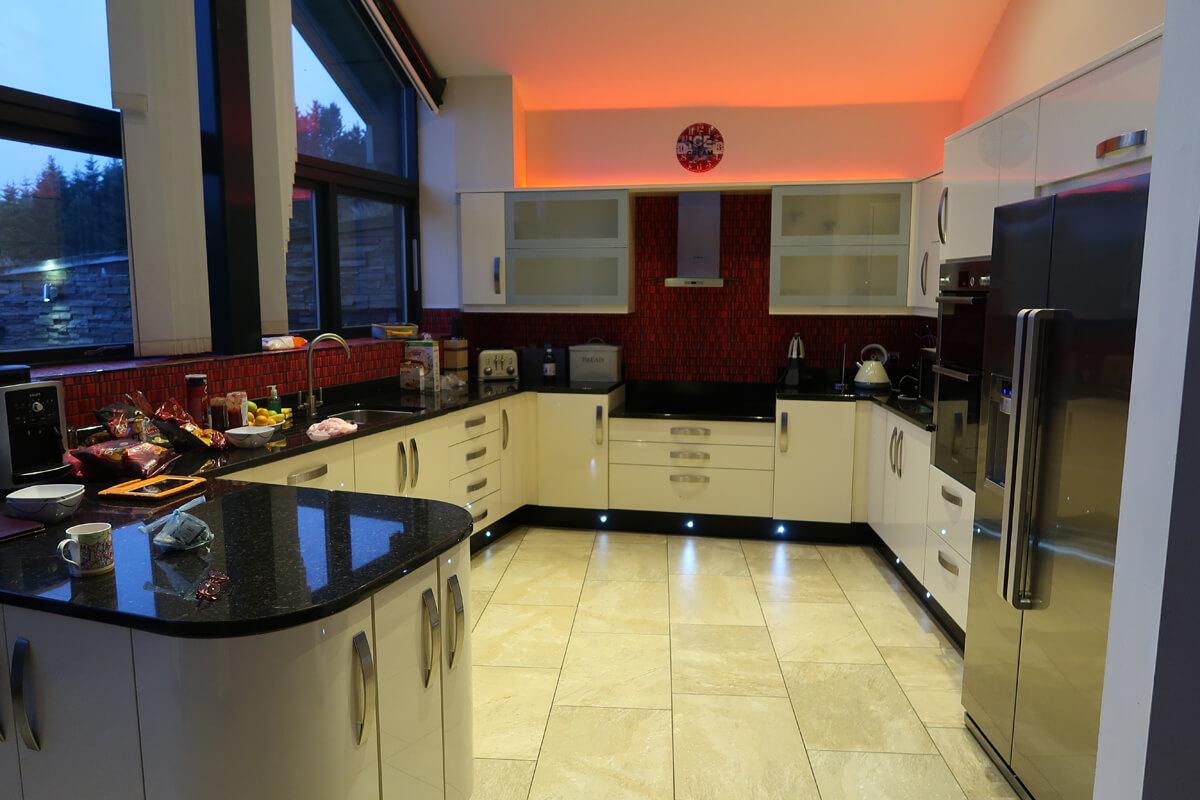 The kitchen at night with the spot lights switched on.