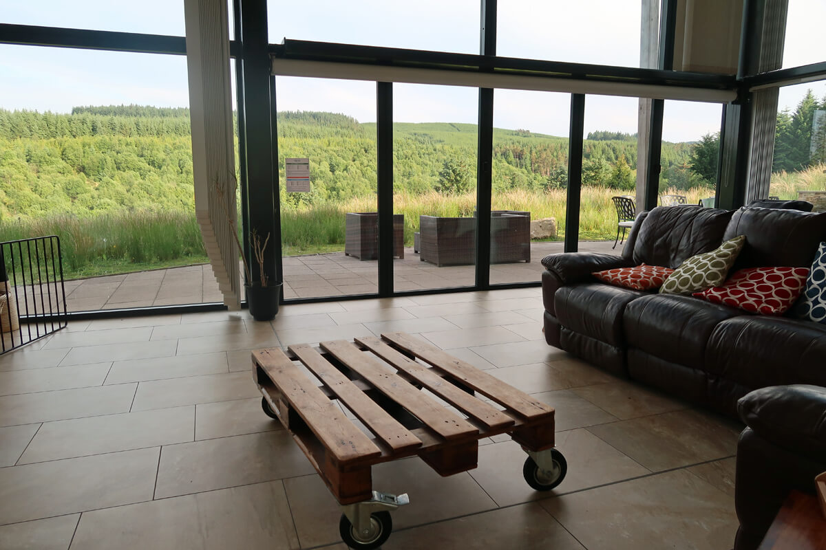 A view out to the forest from the lounge windows.