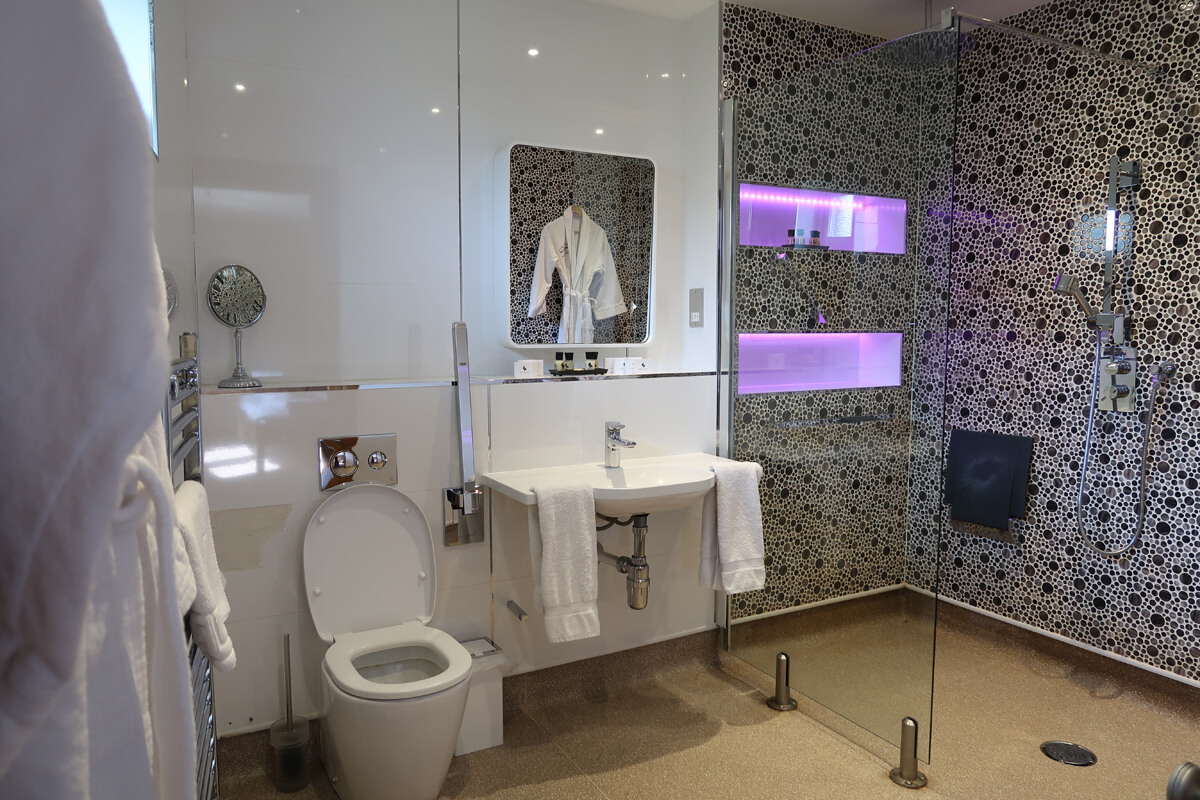 The ensuite accessible bathroom with a roll-in shower.