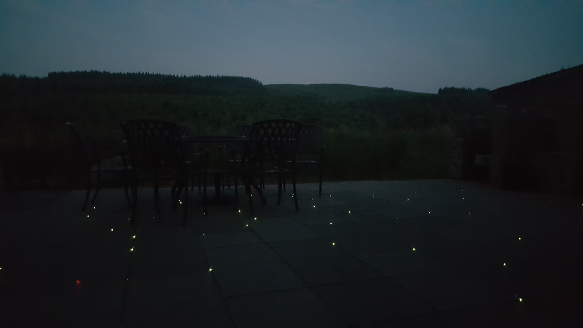 The patio slab lights follow the pattern of the stars and galaxy above the lodge.