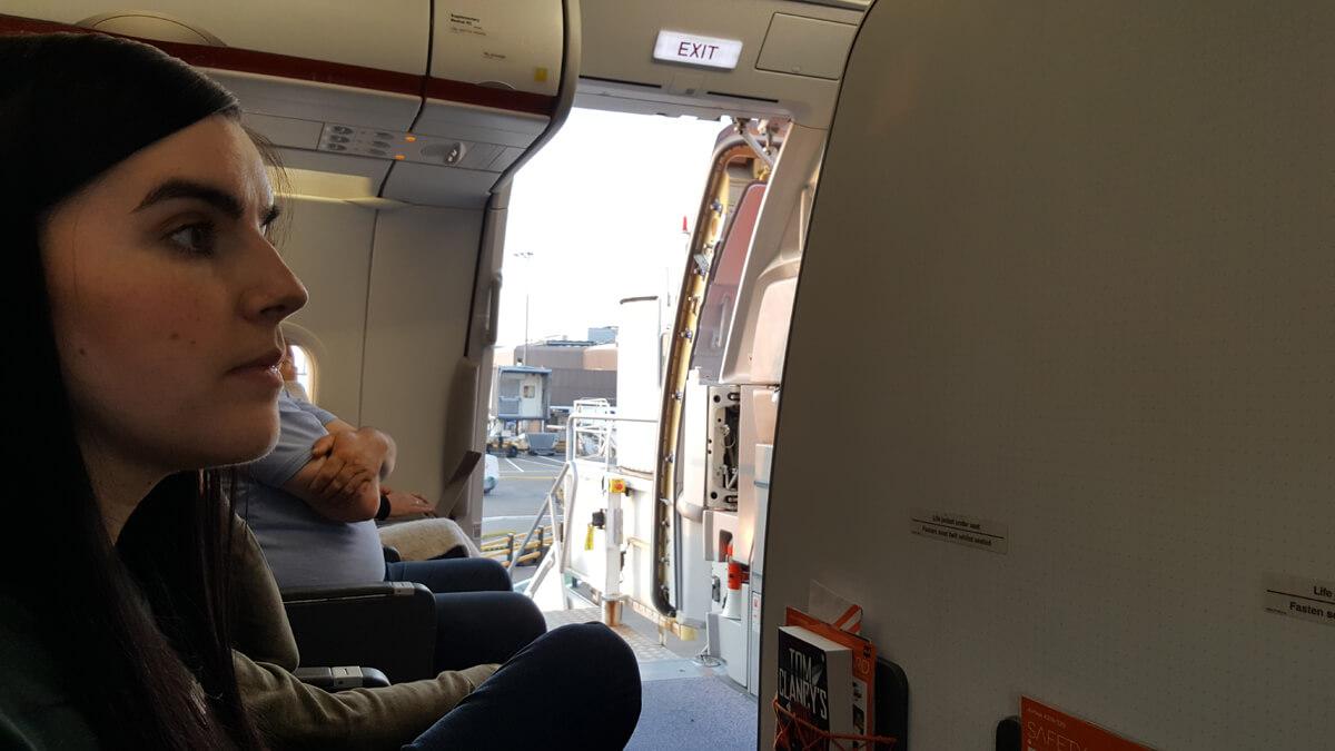 Emma sitting in the bulkhead seats on the easyJet flight.