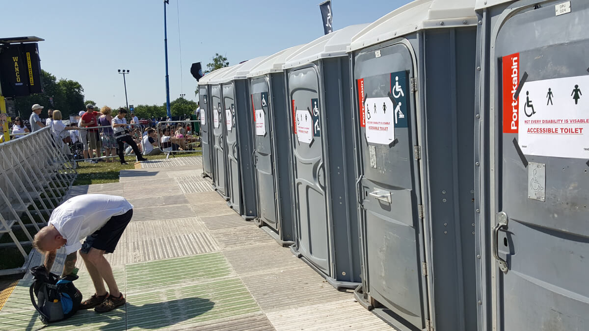 A row of accessible Portakabin toilets next to the Main Stage viewing platform.