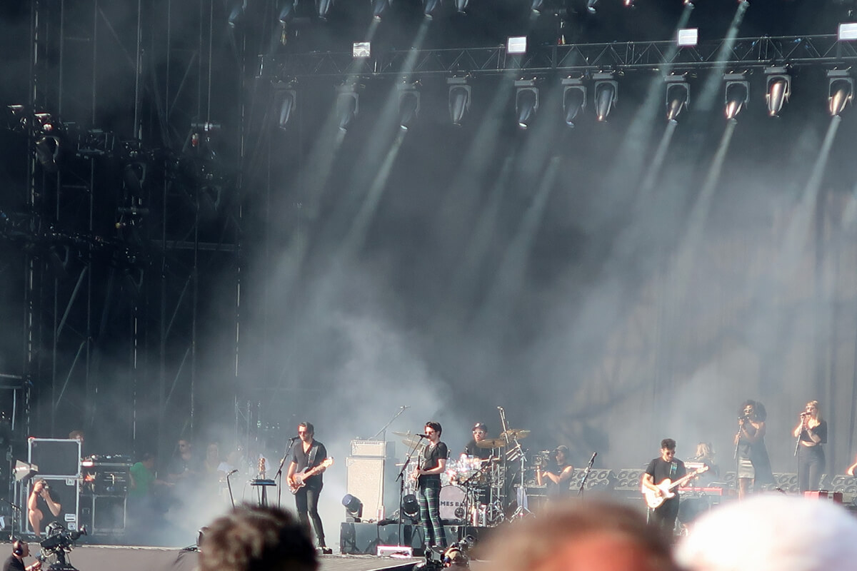 James Bay performing on the main stage at TRNSMT festival Glasgow. James is wearing a black t-shirt and tartan trousers.
