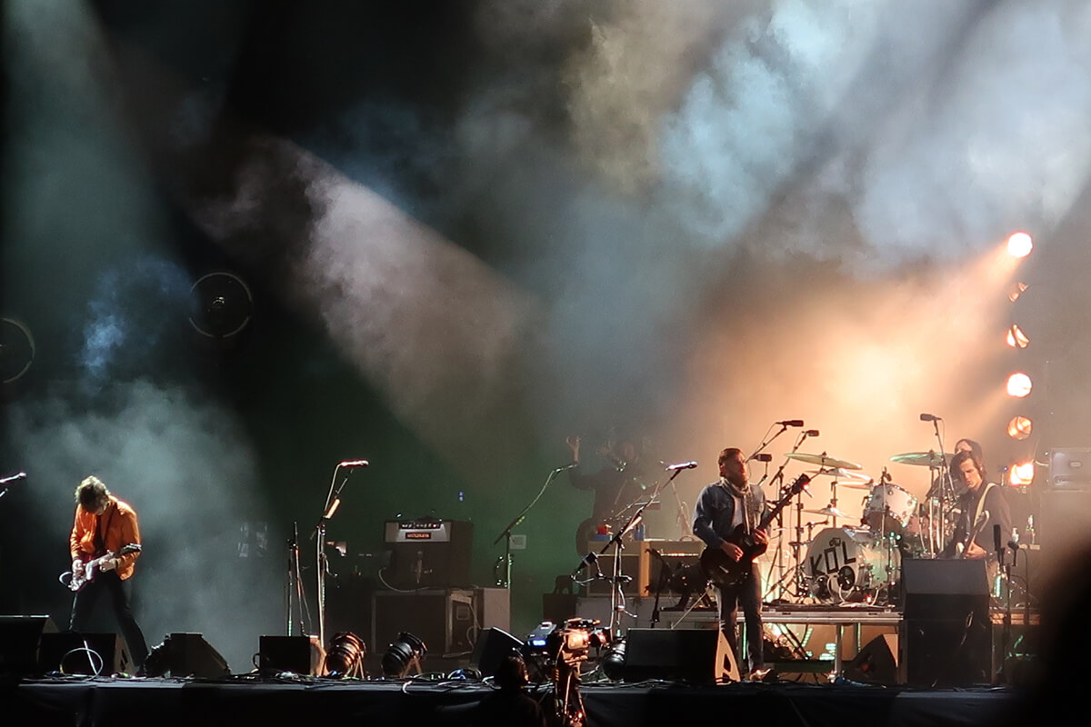A close up of Kings of Leon performing at Glasgow Summer Sessions.