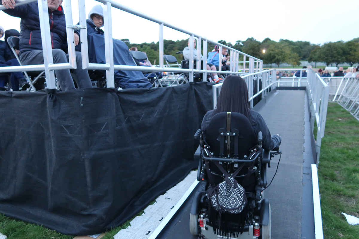Emma driving her wheelchair up the ramp to the viewing platform at Glasgow Summer Sessions.