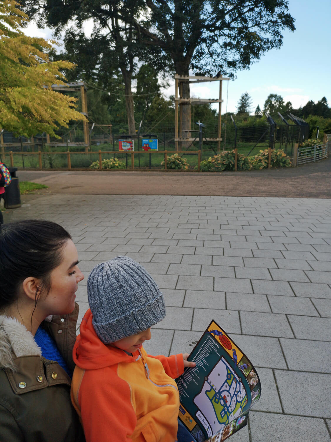 Emma and her nephew looking at a map of Camperdown Wildlife Centre