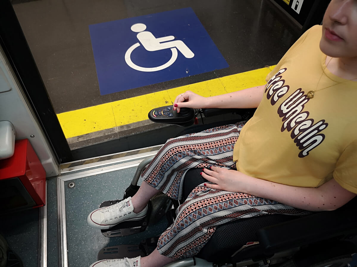 An shot of the uneven platform floor and entrance of the funicular to show access for wheelchairs. Emma is sitting in her wheelchair on the funicular.