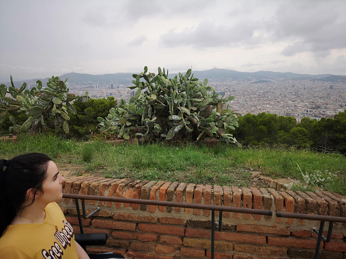 Emma enjoying the view of Barcelona from the hill at Montjuïc Castle.