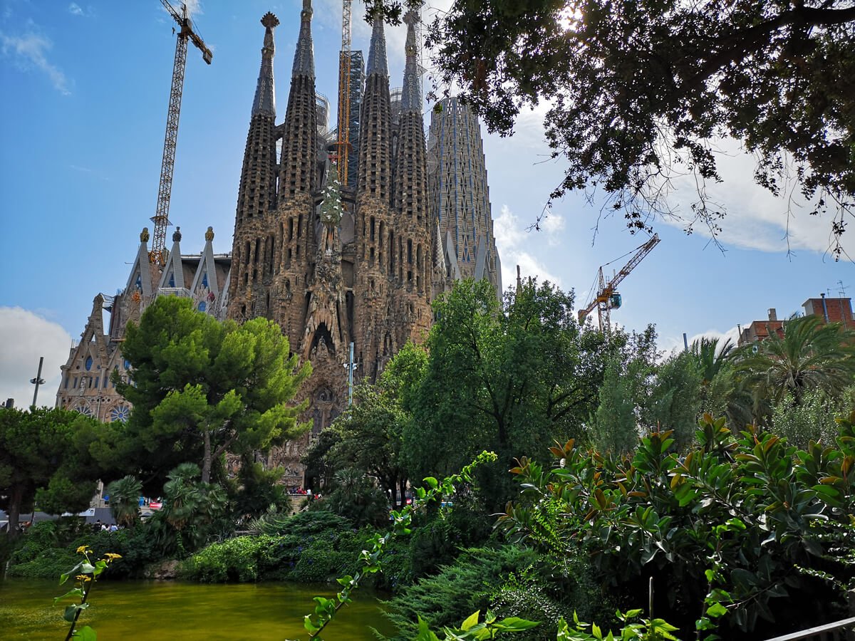 A view of Sagrada Familia from against the lake.