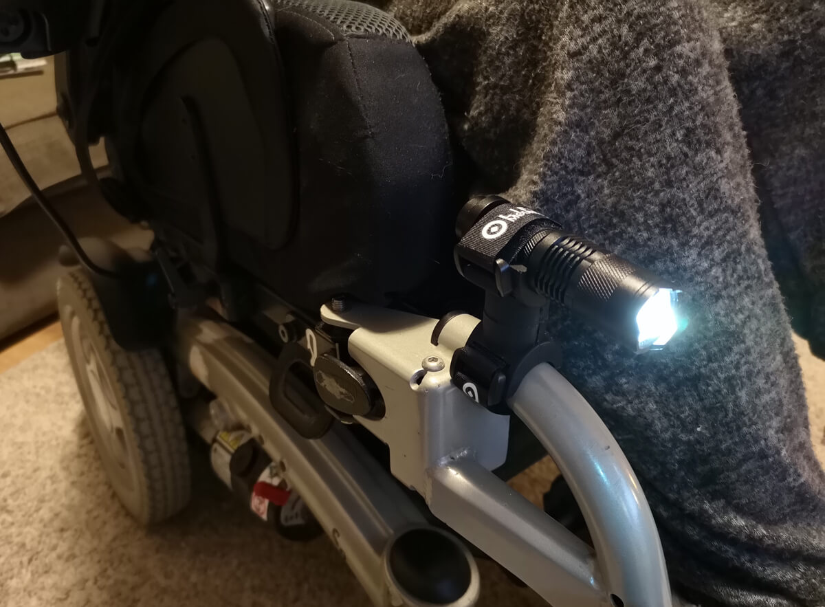 Emma's powered wheelchair now has a light attached from Life Mounts.