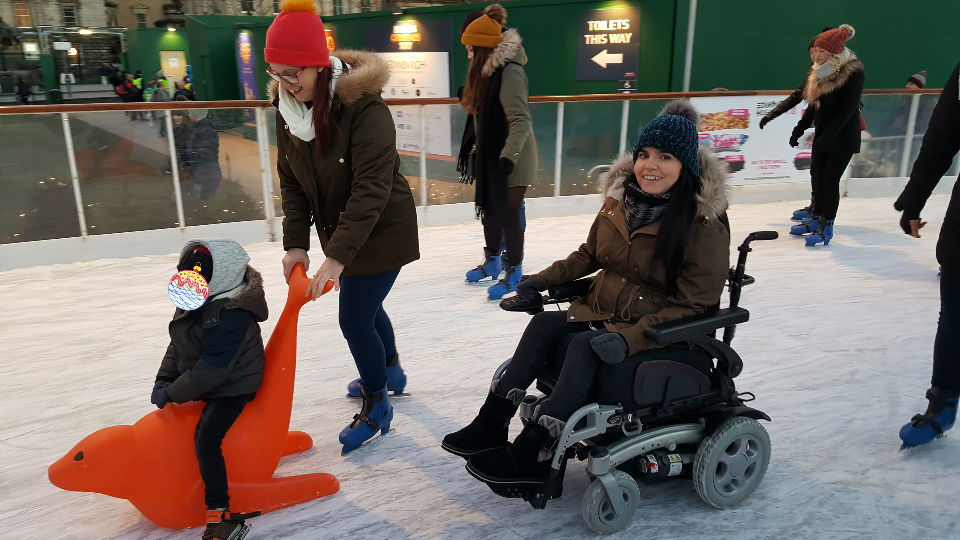 Emma wheelchair ice skating at Edinburgh Christmas